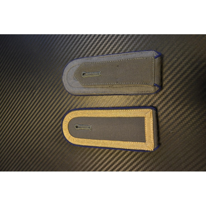 NVA epaulettes - Dark blue side, golden ribbon (closed) on grey background