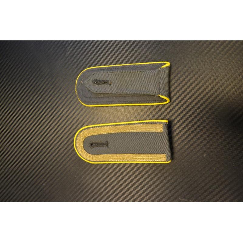 NVA epaulettes - Yellow side, golden ribbon (open) on grey background
